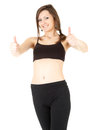 Fitness young woman with thumb up Stock Photo