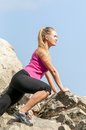 Fitness young woman training on mountain road in beautiful nature caucasian female sport model Royalty Free Stock Photos