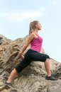 Fitness young woman training on mountain road in beautiful nature caucasian female sport model Stock Images