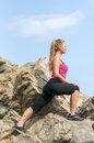 Fitness young woman training on mountain road in beautiful nature caucasian female sport model Royalty Free Stock Photo