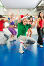 Fitness zumba training and workout in gym young people doing or dance a Royalty Free Stock Photos
