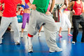 Fitness zumba training and workout in gym young people doing or dance a Stock Photography