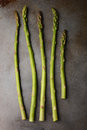 Five asparagus spears on a metal cooking sheet vertical format Stock Photos