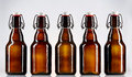 Five blank glass bottles of beer Royalty Free Stock Photo