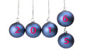 Five blue christmas balls with new year hanging in a row symbolizing turn of the from to Royalty Free Stock Image