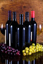 Five bottles of wine and two glasses Royalty Free Stock Photography