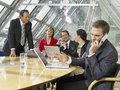 Five business executives in a board room Royalty Free Stock Photos
