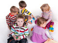 Five children playing colorful toys Stock Photography