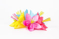 Five colored paper flowers on a white background Stock Photography