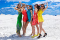 Five Cute sexy girls on the snow ready for party Royalty Free Stock Photography