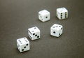 Five dice on a dark table Stock Image