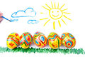 Five easter eggs on grass, sun in sky Stock Photography