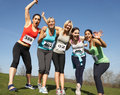 Five female runners training for race smiling to camera Royalty Free Stock Photo