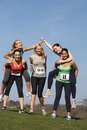 Five female runners training for race smiling to camera Stock Images