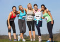 Five female runners training for race smiling to camera Royalty Free Stock Photography
