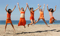 Five girls jumping Royalty Free Stock Image