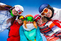 Five happy friends wearing goggles smiling of women and men posing in half circle with ski mask Royalty Free Stock Photo