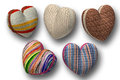 Five hearts individually from knitted fabric separately volumetric d Stock Photo