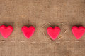 Five hearts on sackcloth can use as background Royalty Free Stock Images