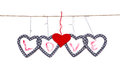Five hearts with the word love hung up on the string Royalty Free Stock Photos