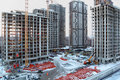 Five high buildings under construction with cranes Royalty Free Stock Photo