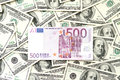Five hundred euro and many one hundred dollars notes Royalty Free Stock Photo