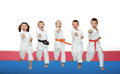 Five karate athletes beat a punch arm Royalty Free Stock Photo