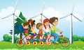 Five kids riding at the bike near the windmills illustration of Stock Image