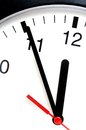 Five minutes to twelve clock showing Stock Photos