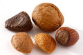 Five mixed nuts on white Royalty Free Stock Photo