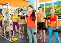 Five nice young people in the fitness club Royalty Free Stock Photo