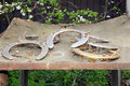 Five old rusty horseshoes as a background at rural horse farm as Royalty Free Stock Photo
