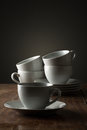 Five plain white ceramic coffee or tea cups Royalty Free Stock Photo