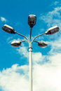Five spot streetlamp in front of a blue sky Stock Photography