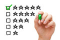 Five star rating hand putting check mark with green marker on Royalty Free Stock Photo