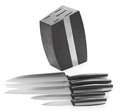 Five steel kitchen knives and knife block Royalty Free Stock Photo