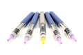 Five syringe pens Royalty Free Stock Photo
