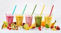 Five tall glasses of tropical fruit smoothies Royalty Free Stock Photo