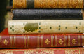 Five very old antiquarian books stacked on side in leather covers Royalty Free Stock Photos