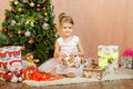 Five-year girl opening Christmas gift Royalty Free Stock Photo