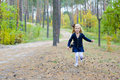 Five year old girl runs in wood emotional Royalty Free Stock Photo