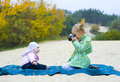 Five year old photographer with small model girl photographs little sister Stock Photo