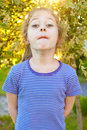 Five years old child girl making faces in the garden portrait of caucasian during summer Royalty Free Stock Photography