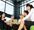 Five young businesspersons are having a meeting Stock Photo