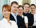 Five young businesspersons in a row Stock Photo