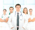 Five young caucasian medical workers together and smart in white clothes standing the image is taken on a light background Royalty Free Stock Photo
