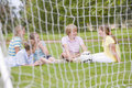 Five young friends on soccer field talking Royalty Free Stock Photo