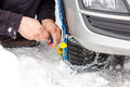 Fix snow chains on car Royalty Free Stock Photo