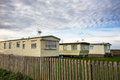 Fixed holiday homes caravans in winter a caravan park Royalty Free Stock Images