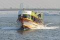 Fixed-route passenger boat `Speed boat` Chao Phraya river. Bangkok,Thailand